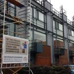 Schilderwerken buiten op hout 21 woningen te Utrecht